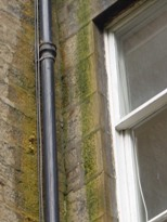 Penetrating damp from a down pipe